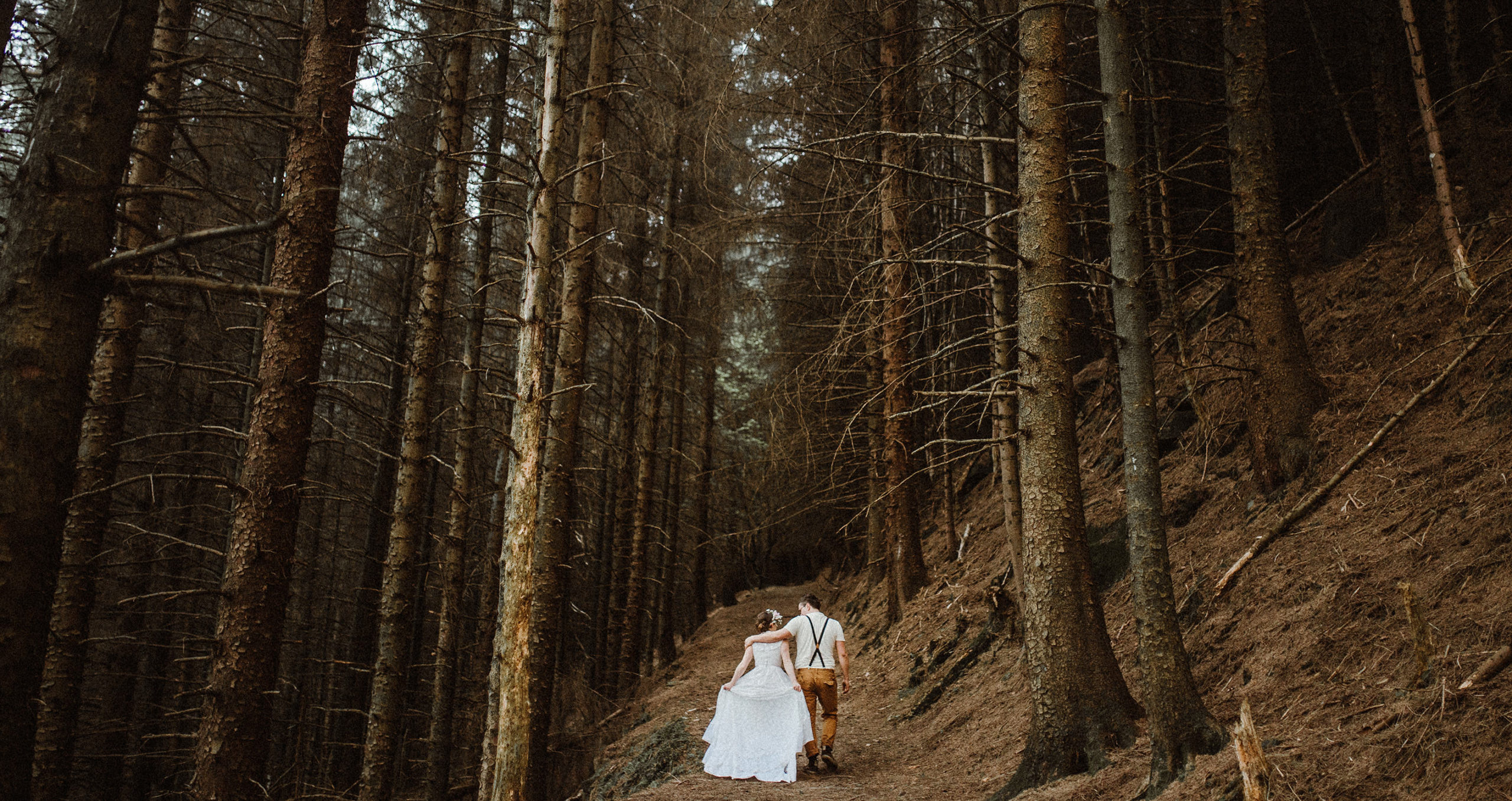 wedding couple walking in the forest